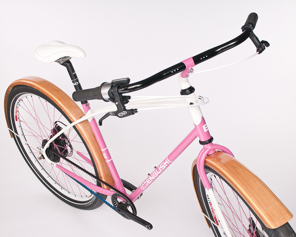 A pink English Cycles commuter bike enabled with Gates Carbon Drive.