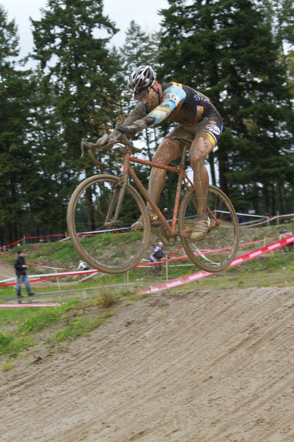 Cross racer flying through the air atop his bicycle equipped with Gates Carbon Drive belt system