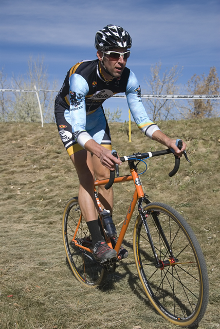 cross racer riding a bicycle equipped with Gates Carbon Drive belt system