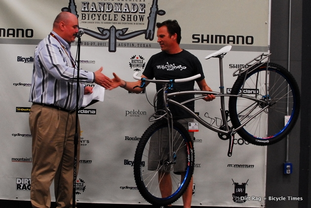 Black Sheep's Jake Kirkpatrick with a Gates Carbon Drive bike at the North American Handmade Bike Show.