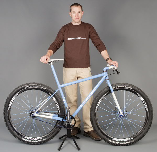 Rob English of English Cycles with a blue Gates Carbon Drive bicycle.