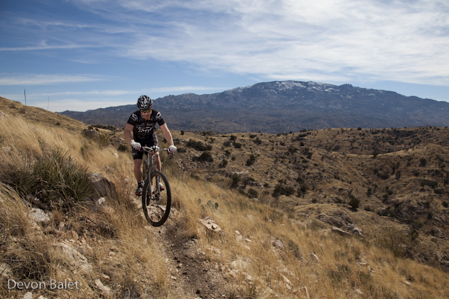 Cyclist Jake Kirkpatrick prepares to embark on the Tour Divide with his Gates Carbon Drive Black Sheep bicycle.