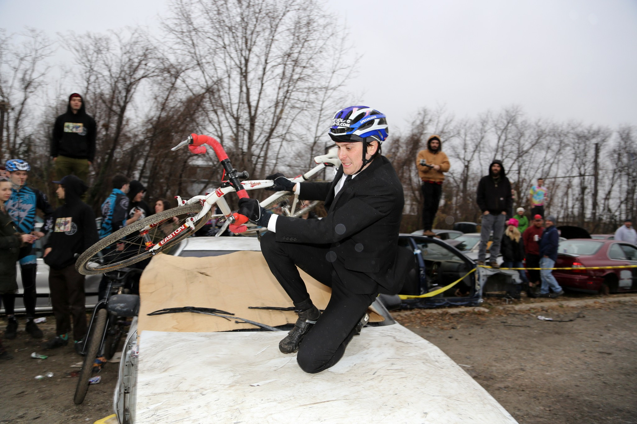 Jordan knee slides over a barrier during a cross race, looking mighty stylish.