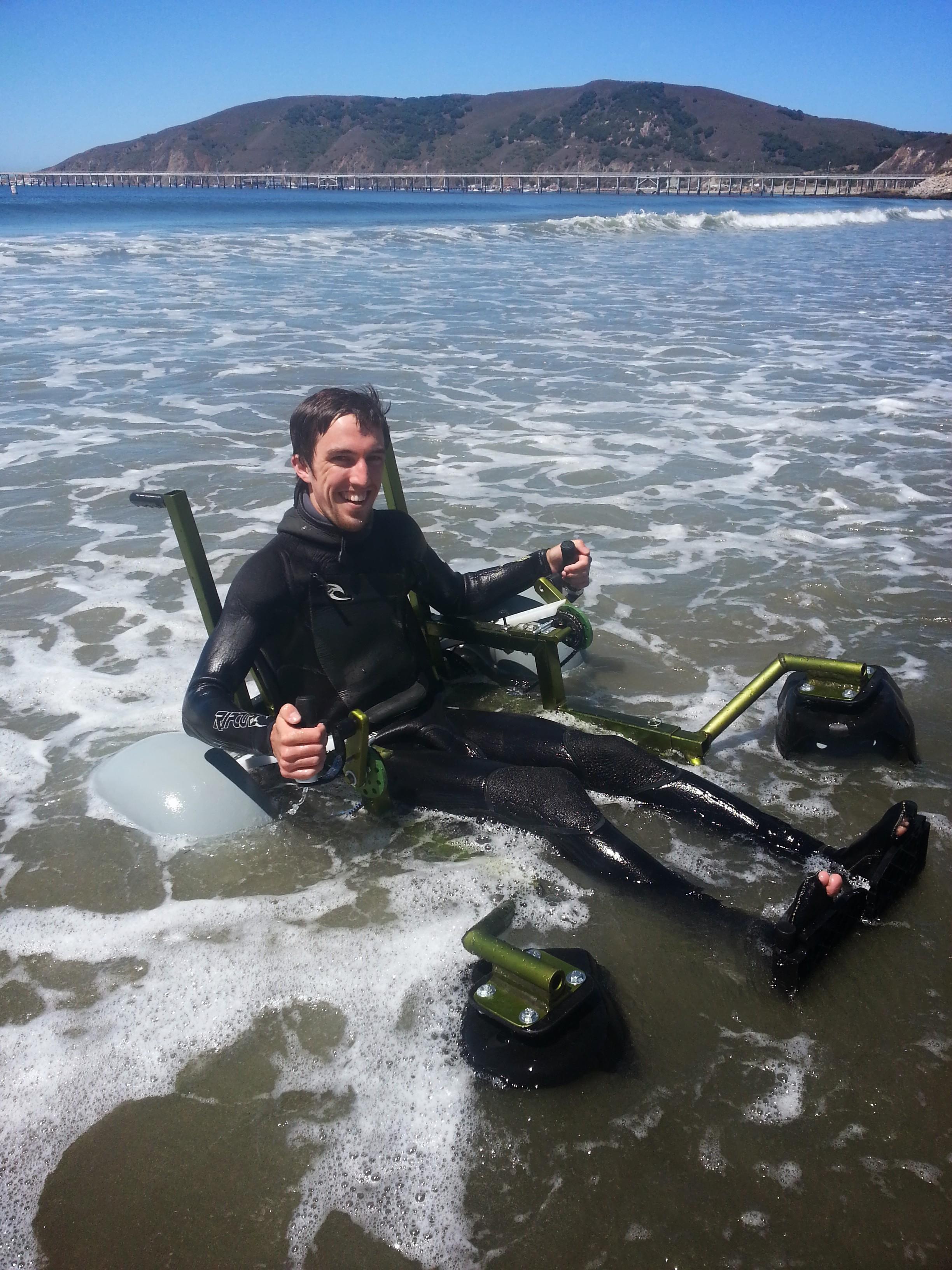 Beach wheel chair in the water