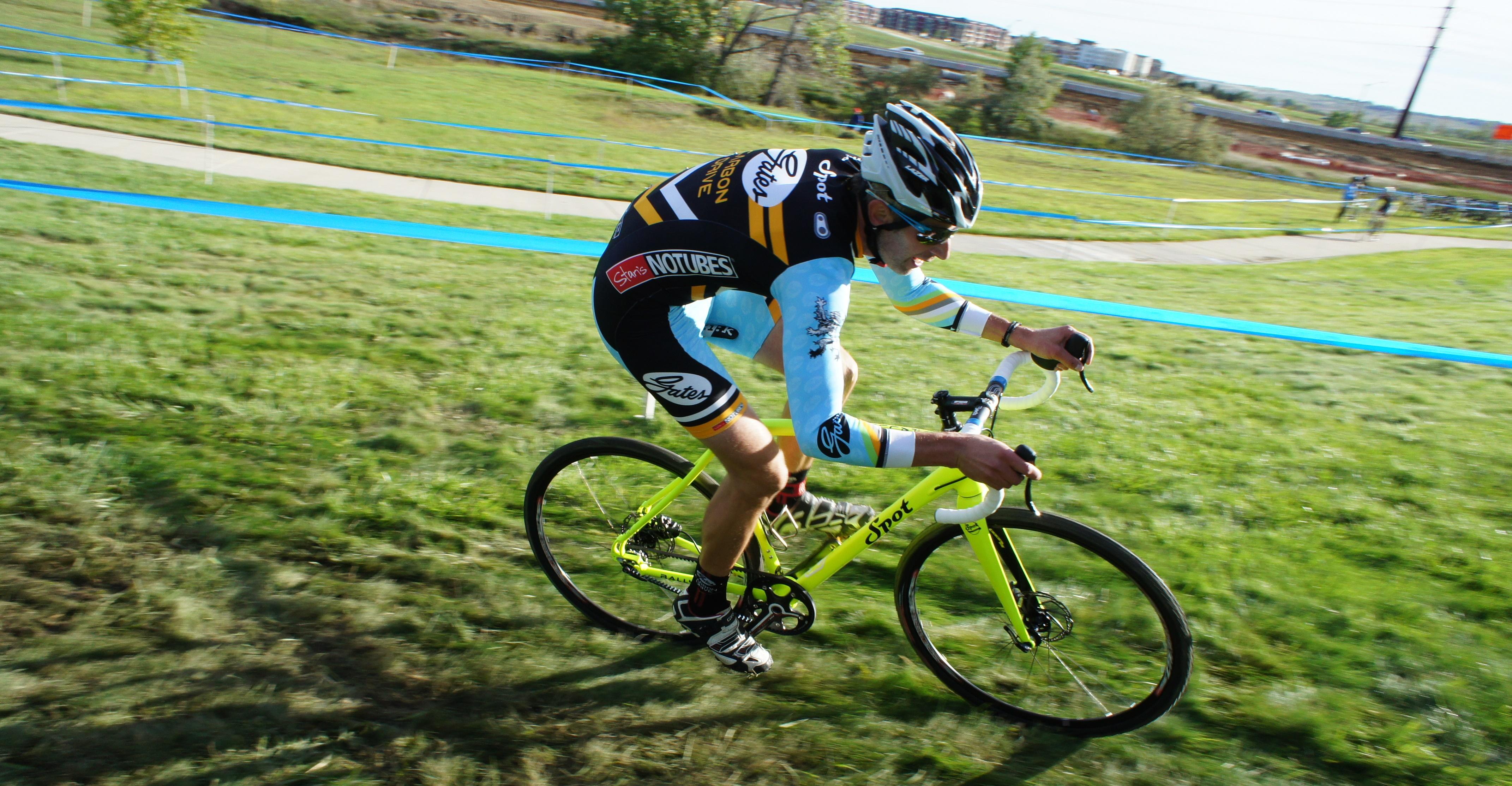 Derek Strong rails a slick grassy corner.
