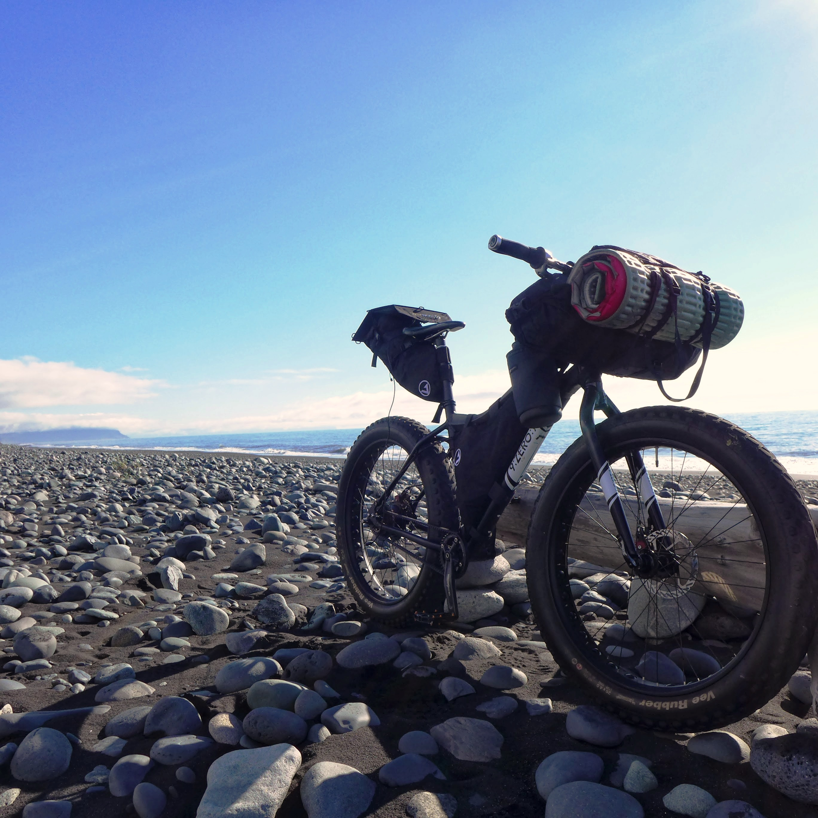 Unchained Iceland_bike on beach with babyheads