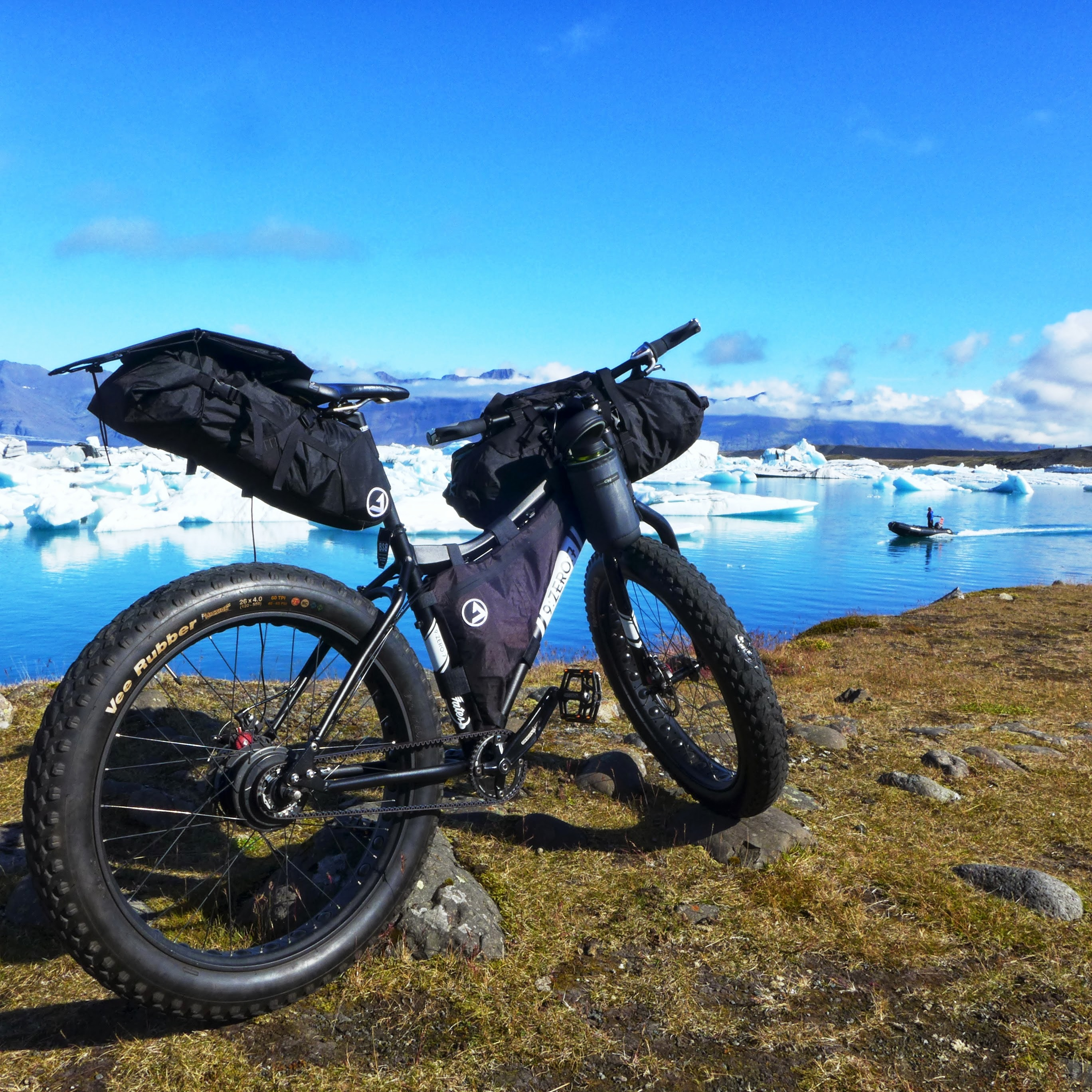 Unchained Iceland_bike with icebergs and skiff