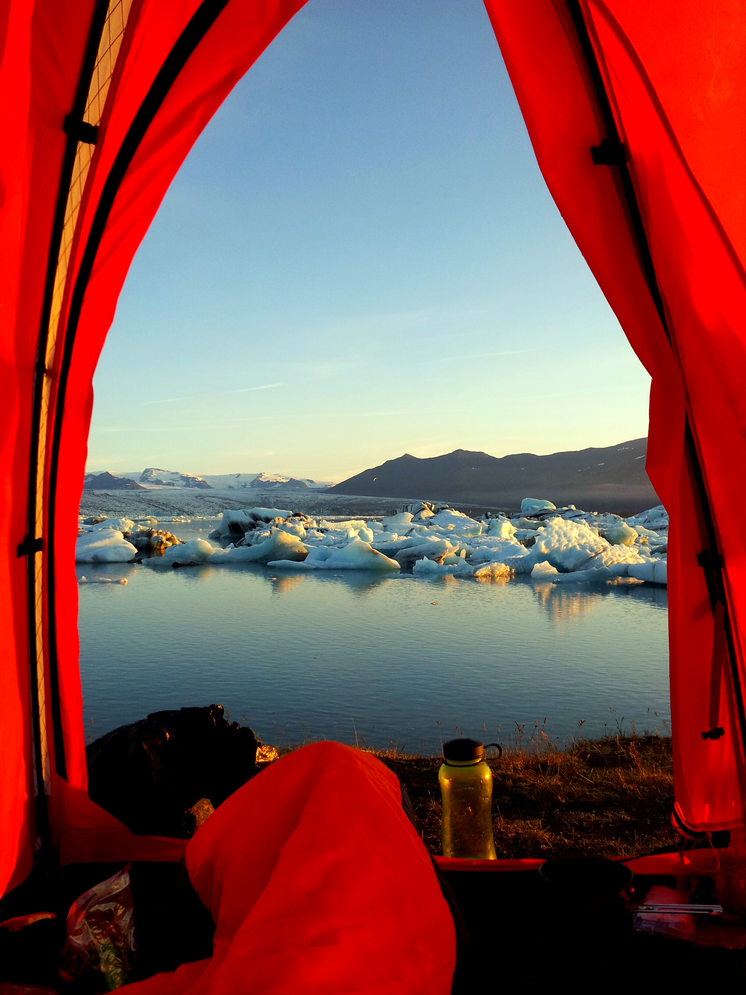 Unchained Iceland_looking out red tent