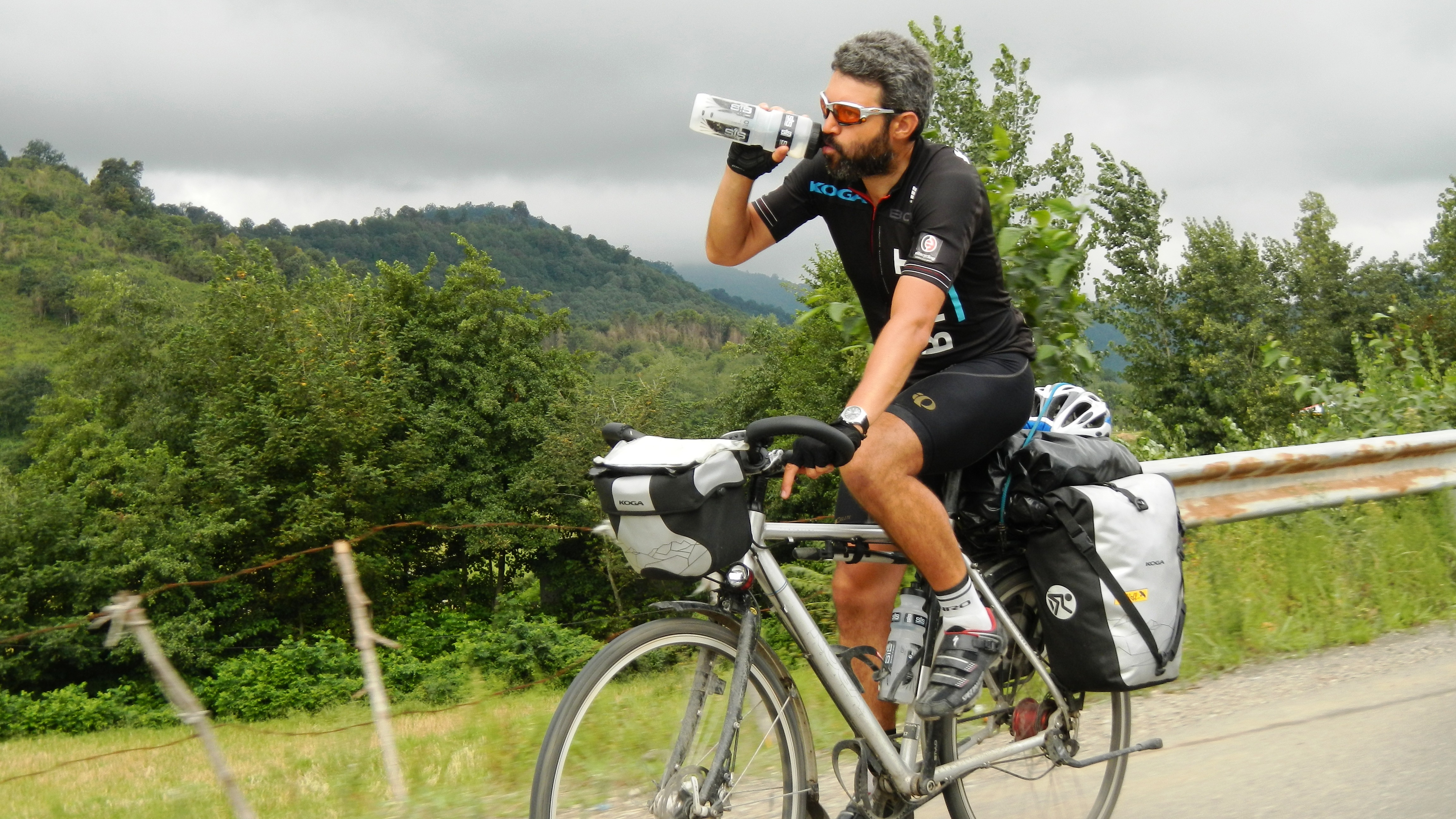 Reza drinking on bike