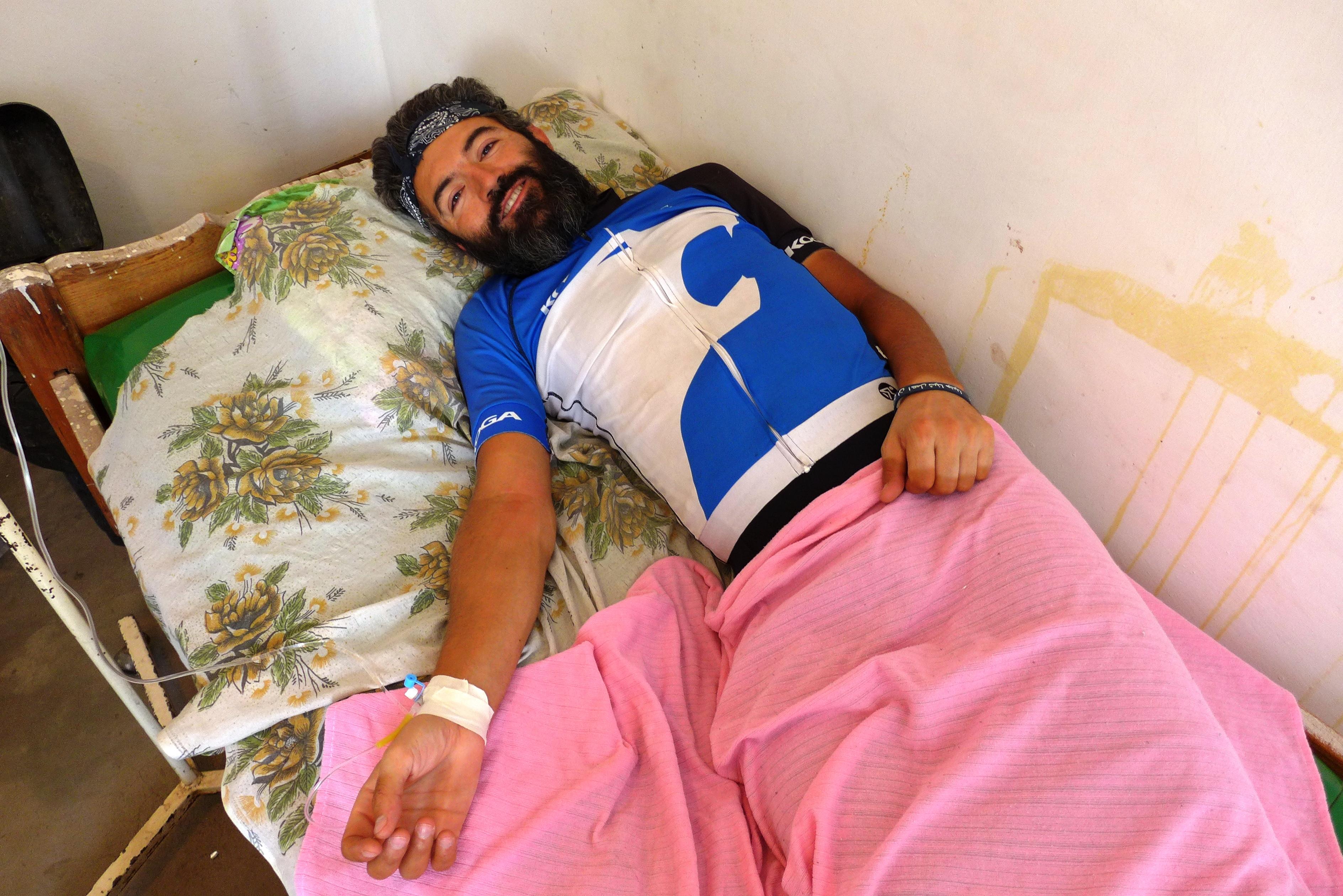 Reza in hospital bed