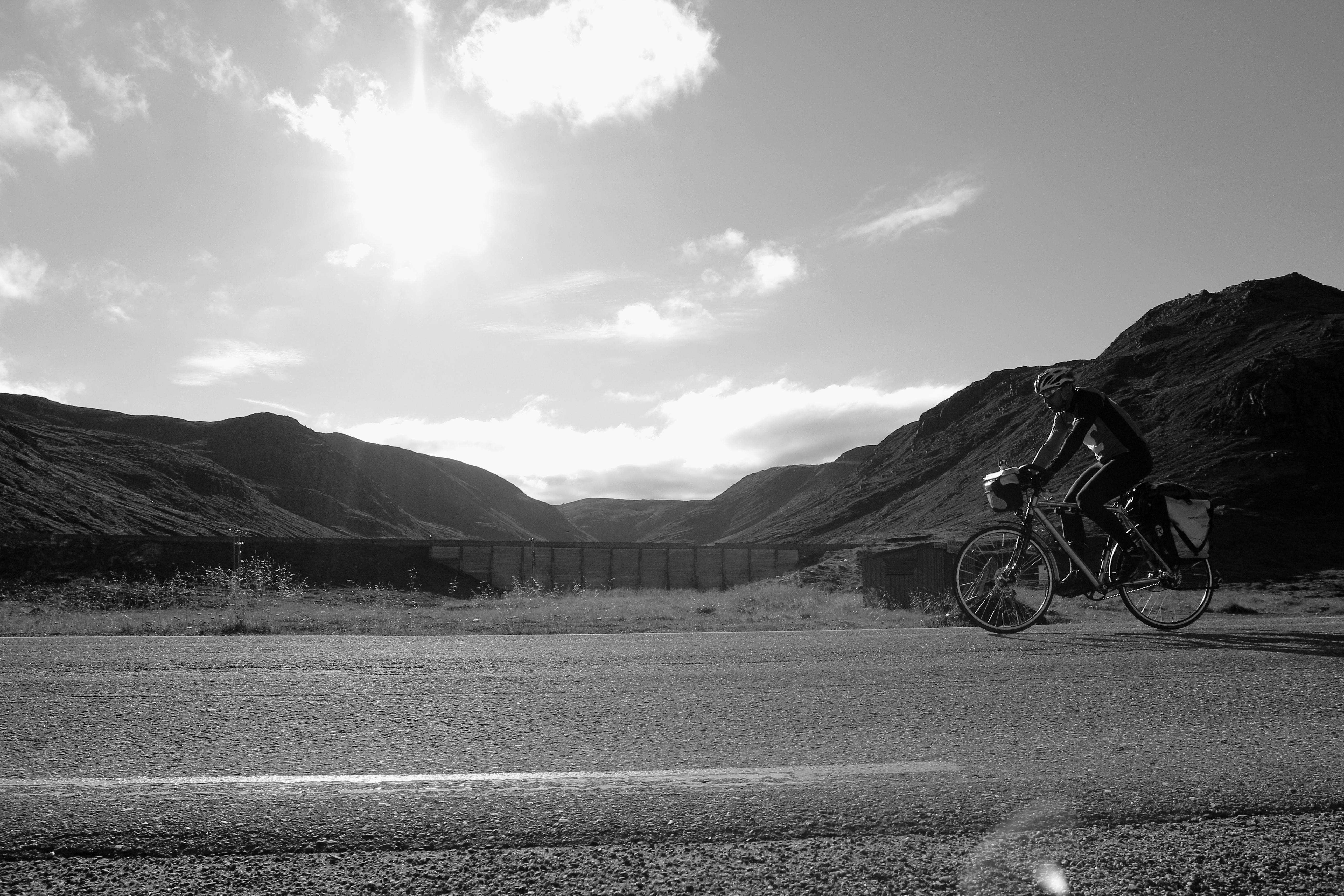 Reza on bike black and white
