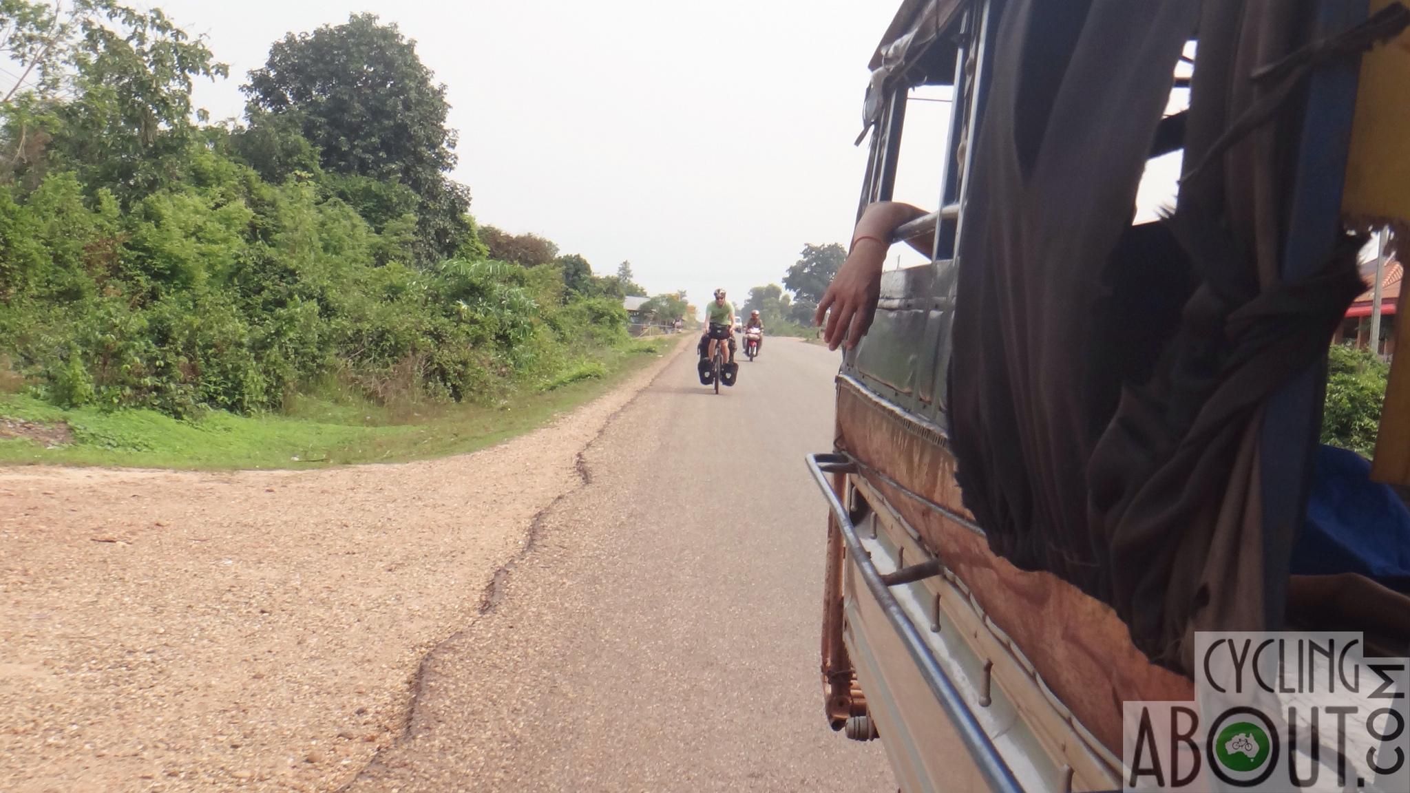 Alleykat_pedaling in Laos behind bus