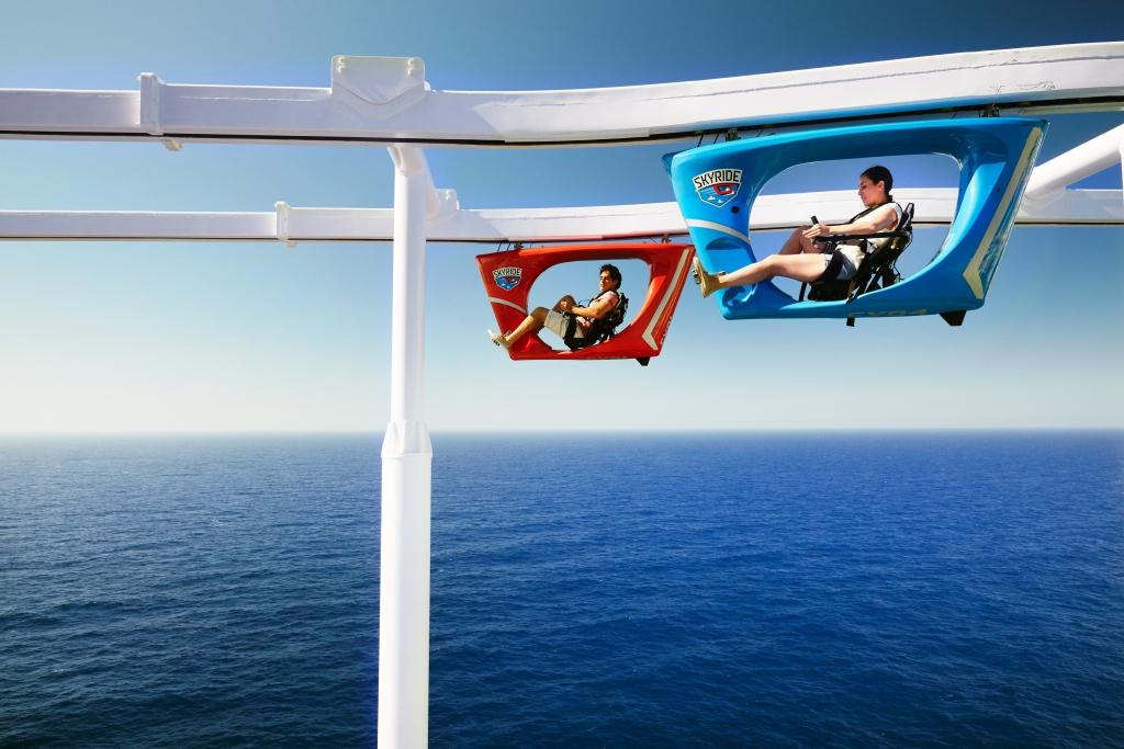 people riding skyride on carnival
