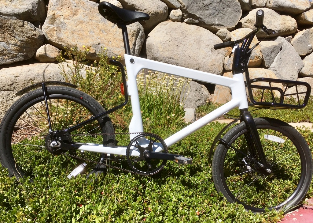 The Volta eBike from Pure: 40 miles of range, belt drive, racks and automatic head and tail lights.